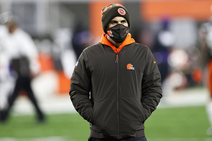 FILE - In this Dec. 14, 2020, file photo, Cleveland Browns coach Kevin Stefanski watches players warm up for the team's NFL football game against the Baltimore Ravens in Cleveland. Stefanski was the name The Associated Press Coach of the Year at the NFL Honors on Saturday, Feb. 6. (AP Photo/Ron Schwane, File)