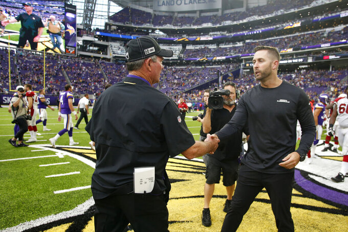 Minnesota Vikings head coach Mike Zimmer, left, greets Arizona Cardinals head coach Kliff Kingsbury after an NFL preseason football game Saturday, Aug. 24, 2019, in Minneapolis. (AP Photo/Bruce Kluckhohn)