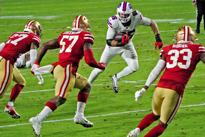 Buffalo Bills tight end Lee Smith (85) runs after the catch as San Francisco 49ers outside linebacker Dre Greenlaw (57), cornerback Dontae Johnson (27) and tight end Chase Harrell (83) defend during the first half of an NFL football game, Monday, Dec. 7, 2020, in Glendale, Ariz. (AP Photo/Rick Scuteri)