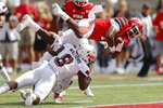 Utah quarterback Tyler Huntley (1) scores against Northern Illinois safety Mykelti Williams (8) in the first half of an NCAA college football game Saturday, Sept. 9, 2019, Salt Lake City. (AP Photo/Rick Bowmer)