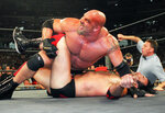 FILE - In this July 6, 1998, file photo, World Championship Wrestling heavyweight champion Bill Goldberg puts Scott Hall to the mat during a match in Atlanta. Bill Goldberg punched through the drywall in his garage one day this week -- not as some sort of masochistic training for his next WWE match --  but for repairs on property damage suffered as a result of the deadly Texas storms. The WWE Hall of Famer spent about 12 hours Wednesday, Feb. 24, 2021 replacing pumps in the wells on the ranch he owns just outside San Antonio, and then it was off to work on a garage and pool house that had been flooded. (AP Photo/Erik S. Lesser, file)