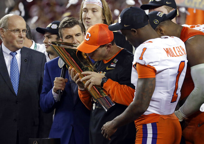 Clemson head coach Dabo Swinney kisses the trophy after the NCAA college football playoff championship game against Alabama, Monday, Jan. 7, 2019, in Santa Clara, Calif. Clemson beat Alabama 44-16. (AP Photo/Chris Carlson)