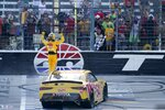Kyle Busch celebrates after winning a NASCAR Xfinity Series auto race at Texas Motor Speedway in Fort Worth, Texas, Saturday, June 12, 2021. (AP Photo/Tony Gutierrez)