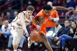 Boston College's Julian Rishwain, left, and Syracuse's Elijah Hughes battle for a loose ball during the first half of an NCAA college basketball game, Tuesday, March, 3, 2020, in Boston. (AP Photo/Michael Dwyer)