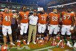 Clemson head coach Dabo Swinney joins his team in singing the Clemson alma mater after an NCAA college football game against South Carolina State on Saturday, Sept. 11, 2021, in Clemson, S.C. (AP Photo/Edward M. Pio Roda)