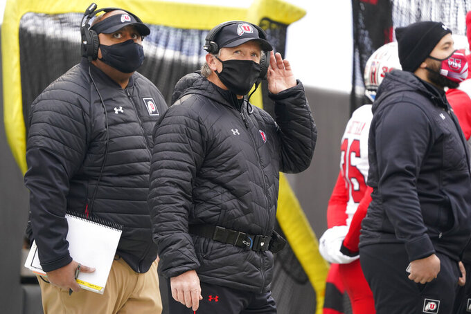 Utah head coach Kyle Whittingham looks on in the second half of an NCAA college football game against Colorado, Saturday, Dec. 12, 2020, in Boulder, Colo. Utah won 38-21. (AP Photo/David Zalubowski)