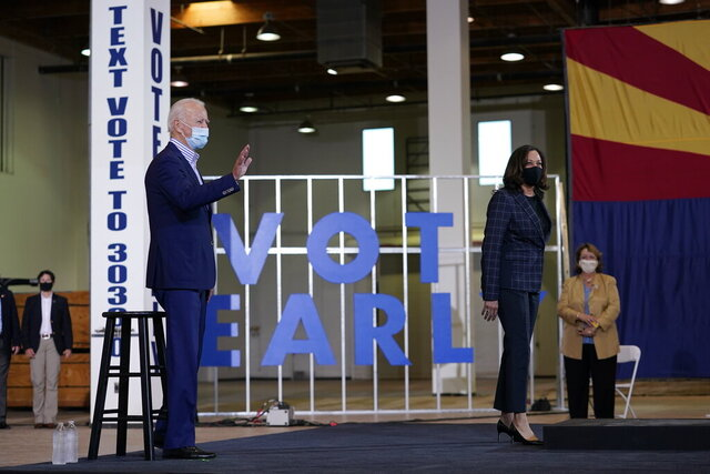 Democratic presidential candidate former Vice President Joe Biden and Democratic vice presidential candidate Sen. Kamala Harris, D-Calif., visit the Carpenters Local Union 1912 in Phoenix, Thursday, Oct. 8, 2020. (AP Photo/Carolyn Kaster)