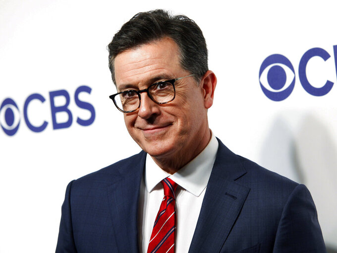 FILE - Stephen Colbert attends the CBS Network 2018 Upfront at The Plaza Hotel in New York on May 16, 2018. Colbert will return to doing live shows before a studio audience on June 14. CBS said Monday that audience members at the Ed Sullivan Theater in New York will be required to show proof of vaccination before being admitted, and face masks will be optional for them. (Photo by Andy Kropa/Invision/AP, File)