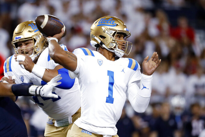UCLA quarterback Dorian Thompson-Robinson (1) throws a pass during the first half of the team's NCAA college football game against Arizona on Saturday, Oct. 9, 2021, in Tucson, Ariz. (AP Photo/Chris Coduto)