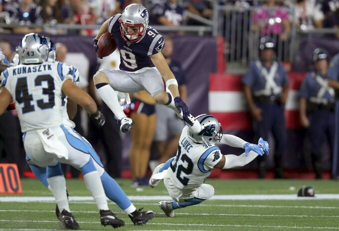 New England Patriots wide receiver Gunner Olszewski (9) leaps over Carolina Panthers cornerback Cole Luke (32) in the first half of an NFL preseason football game, Thursday, Aug. 22, 2019, in Foxborough, Mass. (AP Photo/Charles Krupa)