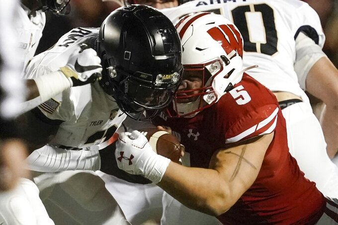 Wisconsin's Leo Chenal hits Army's Tyhier Tyler for a loss during the first half of an NCAA college football game Saturday, Oct. 16, 2021, in Madison, Wis. (AP Photo/Morry Gash)