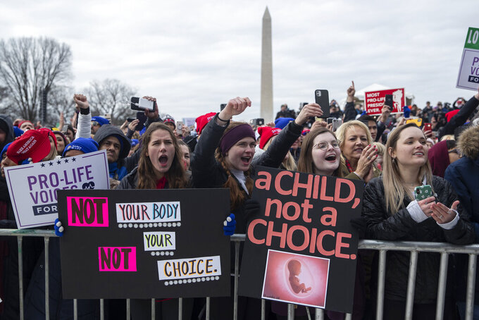"FILE - In this Jan. 24, 2020, file photo, supporters cheer as President Donald Trump speaks during the annual ""March for Life"" rally on the National Mall, in Washington. Anti-abortion leaders across America were elated a year ago when Donald Trump became the first sitting U.S. president to appear in person at their highest-profile annual event, the March for Life held every January. The mood is more sober now — a mix of disappointment over Trump's defeat and hope that his legacy of judicial appointments will lead to future court victories limiting abortion rights. (AP Photo/ Evan Vucci, File)"