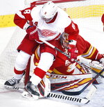 Detroit Red Wings left wing Justin Abdelkader (8) blocks Calgary Flames goalie David Rittich during second-period NHL hockey action in Calgary, Alberta, Thursday, Oct. 17, 2019.  (Larry MacDougal/The Canadian Press via AP)