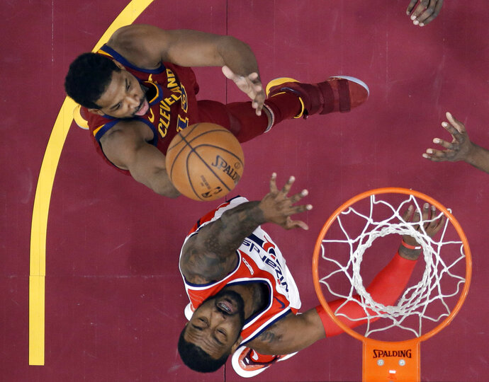 Cleveland Cavaliers' Tristan Thompson shoots over Washington Wizards' John Wall during the first half of an NBA basketball game Saturday, Dec. 8, 2018, in Cleveland. (AP Photo/Tony Dejak)