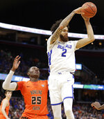 Buffalo's Jeremy Harris (2) passes against Bowling Green's Daeqwon Plowden (25) during the first half of an NCAA college basketball championship game of the Mid-American Conference men's tournament, Saturday, March 16, 2019, in Cleveland. (AP Photo/Tony Dejak)