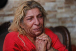 The mother of Danny Abi Haidar, 41, mourns her son who shot himself when he became despondent over salary cuts in recent weeks, according to his family, in Beirut, Lebanon, Wednesday, Dec. 4, 2019. The father of Danny said who worked in a lightning company, spent the day Tuesday warding off creditors, explaining that he only received half of his salary because of the economic crisis. Many private companies have resorted to reducing staff or slashing their pay to deal with the rising inflation and liquidity crunch. (AP Photo/Hussein Malla)
