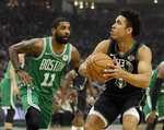 Milwaukee Bucks' Malcolm Brogdon looks to shoot against Boston Celtics' Kyrie Irving during the first half of an NBA basketball game Thursday, Feb. 21, 2019, in Milwaukee. (AP Photo/Aaron Gash)