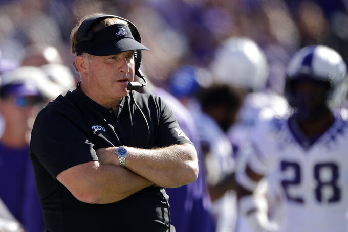 FILE - In this Oct. 19, 2019, file photo, TCU coach Gary Patterson watches during the first half of the team's NCAA college football game against Kansas State in Manhattan, Kan. The coronavirus pandemic has caused TCU coach Gary Patterson to pay attention to the details of things he never would have thought about in the past. He's going into his 20th season as head coach of the Horned Frogs. The virus has altered how things are being done on and off the field. (AP Photo/Charlie Riedel, File)