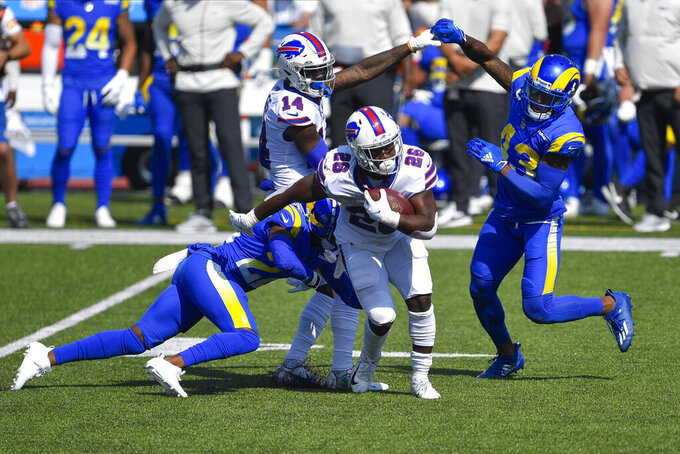 Buffalo Bills running back Devin Singletary (26) runs past Los Angeles Rams' John Johnson (43) during the first half of an NFL football game Sunday, Sept. 27, 2020, in Orchard Park, N.Y. (AP Photo/Adrian Kraus)