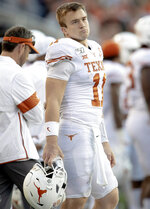 Texas quarterback Sam Ehlinger (11) stands on the sideline during an NCAA college football game against Baylor on Saturday, Nov. 23, 2019, in Waco, Texas. (Nick Wagner/Austin American-Statesman via AP)