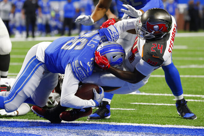 Detroit Lions running back Wes Hills is tackled by Tampa Bay Buccaneers strong safety Darian Stewart (24) after scoring during the second half of an NFL football game, Sunday, Dec. 15, 2019, in Detroit. (AP Photo/Paul Sancya)