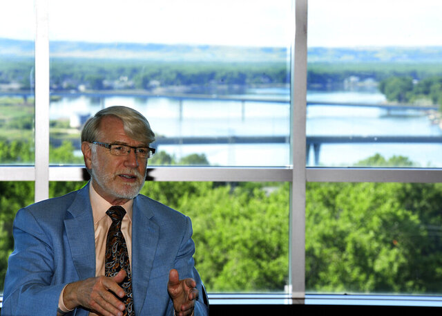 Larry Skogen talks on June 26, 2020 about his time as president of Bismarck State College Friday, June 26, 2020 with a panoramic view of the Missouri River in the background from the National Energy Center of Excellence building in Bismarck, North Dakota. Skogen will retire as the sixth president after serving since 2007.   (Mike McCleary/The Bismarck Tribune via AP)