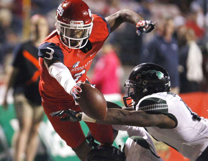 Fresno State wide receiver KeeSean Johnson tries to leap over the goal line against a Hawaii defender during the second half of an NCAA college football game in Fresno, Calif., Saturday, Oct. 27, 2018. Fresno State won 50-20. (AP Photo/Gary Kazanjian)