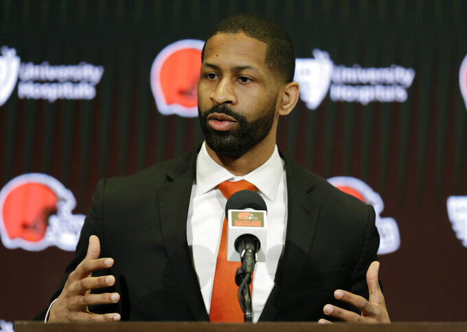 """FILE - In this Feb. 5, 2020, file photo, Cleveland Browns general manager Andrew Berry speaks during a news conference at the NFL football team's training camp facility in Berea, Ohio. The NFL's salary cap will be $182.5 million per team in the upcoming season, a drop of 8% from 2020. """"If you look league-wide at the available cap dollars, it is like 40 percent of what it has been in the past,"""" Andrew Berry, Cleveland's executive vice president of football operations, said last week.  (AP Photo/Tony Dejak, File)"""