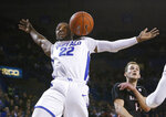 Buffalo guard Dontay Caruthers (22) reacts after dunking during the second half of the team's NCAA college basketball game against Ball State, Tuesday, Jan. 29, 2019, in Buffalo, N.Y. (AP Photo/Jeffrey T. Barnes)