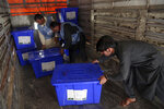 In this Monday, Sept. 23, 2019 photo, Afghan election workers load ballot boxes and other election materials on a truck for distribution ahead of presidential elections scheduled for Sept. 28, at the Independent Election Commission compound, in Kabul, Afghanistan. The Taliban have warned Afghanistan's 9.6 million eligible voters to stay away from polling stations during Saturday's presidential election. It's unclear how many will heed those warnings, but turnout is expected to be depressed as a result. (AP Photo/Rahmat Gul)