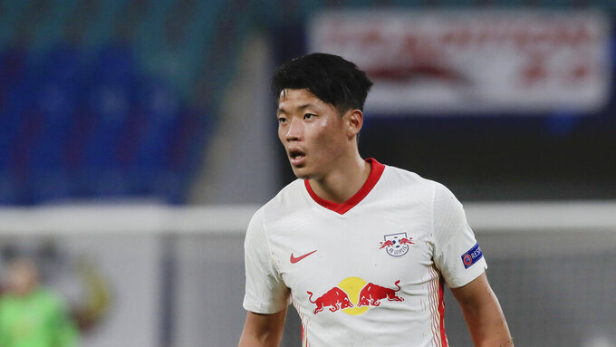 """FILE - In this Tuesday, Oct. 20, 2020 file photo, Leipzig's Hwang Hee-chan runs during their Champions League group H soccer match against Basaksehir Istanbul in Leipzig, Germany. Hwang Hee-chan felt """"almost dead"""" for a week when he was infected with the coronavirus, coach Julian Nagelsmann said Friday, Dec. 11. Hwang tested positive last month after returning from the South Korean national team's friendly games in Austria against Mexico and Qatar. (AP Photo/Markus Schreiber, file)"""
