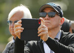 Triple Crown hopeful Justify owner Teo Ah Khing, of the China Horse Club, records workouts on his phone at Belmont Park, Friday, June 8, 2018, in Elmont, N.Y. Justify will attempt to become the 13th Triple Crown winner when he races in the 150th running of the Belmont Stakes horse race on Saturday. (AP Photo/Julie Jacobson)