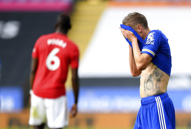 Leicester's Jamie Vardy wipes his face during the English Premier League soccer match between Leicester City and Manchester United at the King Power Stadium, in Leicester, England, Sunday, July 26, 2020. (Michael Regan/Pool via AP)