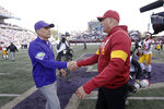 Washington head coach Chris Petersen, left, shakes hands with Southern Cal head coach Clay Helton after an NCAA college football game Saturday, Sept. 28, 2019, in Seattle. Washington won 28-14. (AP Photo/Elaine Thompson)