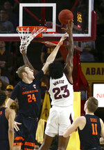Arizona State forward Romello White (23) shoots over Oregon State forward Kylor Kelley (24) as Oregon State guard Zach Reichle (11) looks on during the first half of an NCAA college basketball game, Thursday, Jan. 17, 2019, in Tempe, Ariz. (AP Photo/Ross D. Franklin)