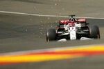 Alfa Romeo driver Kimi Raikkonen of Finland steers his car during the second practice session prior to the Formula One Grand Prix at the Spa-Francorchamps racetrack in Spa, Belgium, Friday, Aug. 27, 2021. The Belgian Formula One Grand Prix will take place on Sunday. (AP Photo/Francisco Seco)