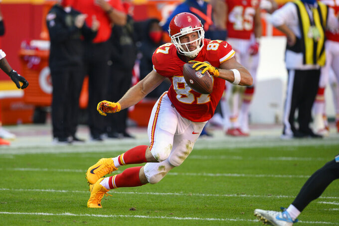 FILE - In this Nov. 8, 2020, file photo, Kansas City Chiefs tight end Travis Kelce makes a move during the second half of the team's NFL football game against the Carolina Panthers in Kansas City, Mo. Kelce was a unanimous choice Friday, Jan. 8, 2021, for The Associated Press NFL All-Pro Team. (AP Photo/Reed Hoffmann, File)