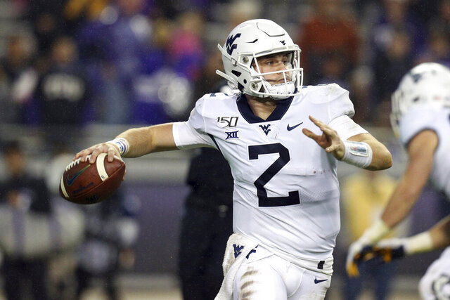 FILE - In this Nov. 29, 2019, file photo, West Virginia quarterback Jarret Doege (2) looks for an open receiver against TCU in an NCAA college football game in Fort Worth, Texas. Doege started three games during a redshirt season in 2019 and is battling veteran Austin Kendall to win the starting job again. (AP Photo/Richard W. Rodriguez, File)