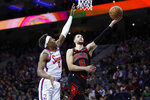 Chicago Bulls' Zach LaVine, right, goes up to shoot against Philadelphia 76ers' Josh Richardson during the first half of an NBA basketball game, Friday, Jan. 17, 2020, in Philadelphia. (AP Photo/Matt Slocum)