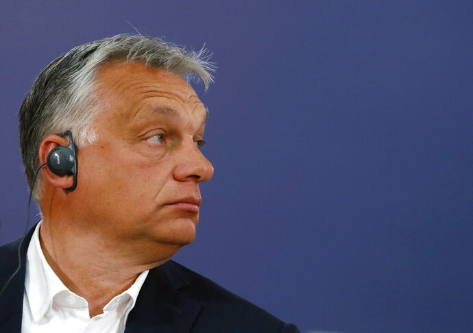 Hungarian Prime Minister Viktor Orban listens to a question during a press conference after a meeting with Serbian President Aleksandar Vucic in Belgrade, Serbia, Friday, May 15, 2020. Orban is on a one-day official visit to Serbia. (AP Photo/Darko Vojinovic)