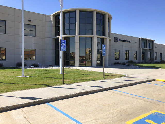 """The John Deere Electronic Solutions plant in Fargo, N.D., shown on Thursday, April 30, 2020, employs about 750 people and has remained open during the COVID-19 epidemic. A company spokeswoman says """"one of the most impactful steps"""" they've taken is to assure employees they will be paid if they have symptoms of the virus, don't feel well or believe they could have been exposed. The company offers products and services for agriculture, construction, forestry and turf care. (AP Photo/Dave Kolpack) (AP Photo/Dave Kolpack)"""
