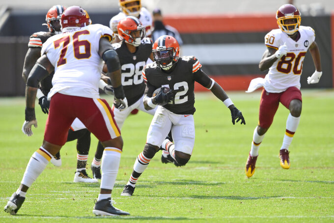 Cleveland Browns free safety Karl Joseph (42) returns the ball after an interception during the first half of an NFL football game against the Washington Football Team, Sunday, Sept. 27, 2020, in Cleveland. (AP Photo/David Richard)