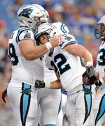 Carolina Panthers running back Christian McCaffrey (22) is congratulated by center Tyler Larsen (69) after scoring a touchdown against the Buffalo Bills during the first half of an NFL football game, Thursday, Aug. 9, 2018, in Orchard Park, N.Y. (AP Photo/Adrian Kraus)