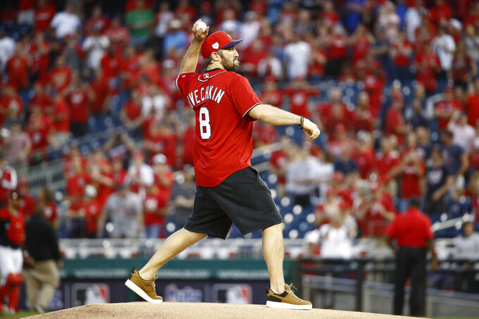 Washington Capitals hockey player Alex Ovechkin throws out a ceremonial first pitch before Game 4 of a baseball National League Division Series between the Los Angeles Dodgers and the Washington Nationals, Monday, Oct. 7, 2019, in Washington. (AP Photo/Patrick Semansky)