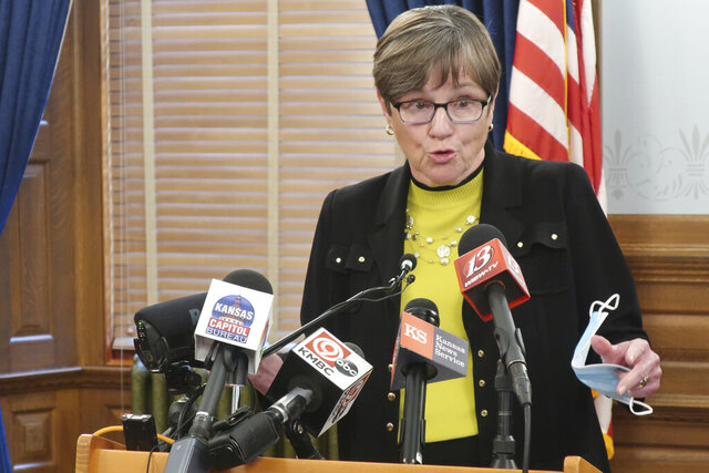 Kansas Gov. Laura Kelly speaks to reporters about the coronavirus pandemic during a news conference, Monday, July 6, 2020, at the Statehouse in Topeka, Kan. The state has seen its worst two-week spike in coronavirus cases since the pandemic began and Kelly is warning the public and local officials that wearing masks are necessary to check its spread. (AP Photo/John Hanna)