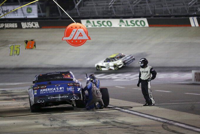 An official watches as a pit crew works on the car belonging to Justin Allgaier during NASCAR Xfinity Series auto race at Bristol Motor Speedway Monday, June 1, 2020, in Bristol, Tenn. (AP Photo/Mark Humphrey)