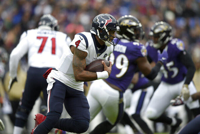 Houston Texans quarterback Deshaun Watson runs with the ball against the Baltimore Ravens during the first half of an NFL football game, Sunday, Nov. 17, 2019, in Baltimore. (AP Photo/Gail Burton)