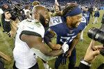 Jacksonville Jaguars running back Leonard Fournette (27) and Tennessee Titans running back Derrick Henry (22) laugh after an NFL football game Sunday, Nov. 24, 2019, in Nashville, Tenn. The Titans won 42-20. (AP Photo/Mark Zaleski)