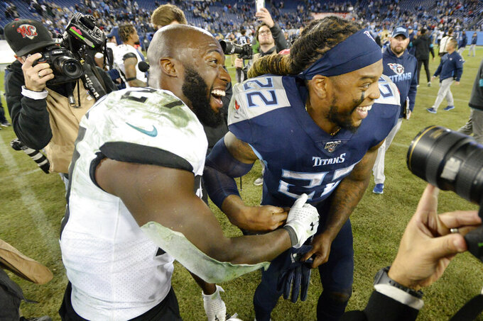 Jacksonville Jaguars running back Leonard Fournette (27) and Tennessee Titans running back Derrick Henry (22) laugh after an NFL football game Sunday, Nov. 24, 2019, in Nashville, Tenn. The Titans won 42-20. (AP Photo/Mark Zaleski)