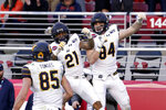 California tight end Gavin Reinwald (84) celebrates with Ricky Walker III (21) after scoring a touchdown against Illinois during the second half of the Redbox Bowl NCAA college football game Monday, Dec. 30, 2019, in Santa Clara, Calif. (AP Photo/Tony Avelar)
